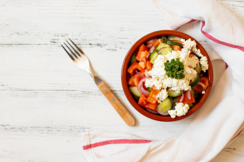 Traditional shopska salad with fresh vegetables and cheese