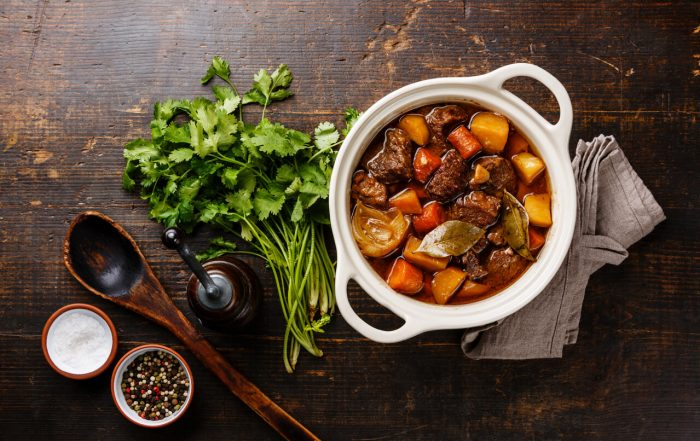 Beef meat stewed with potatoes in pot