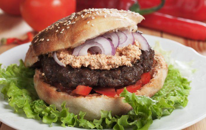 Pljeskavica, Serbian Ground Beef Burger With Onion and Urnebes Salad