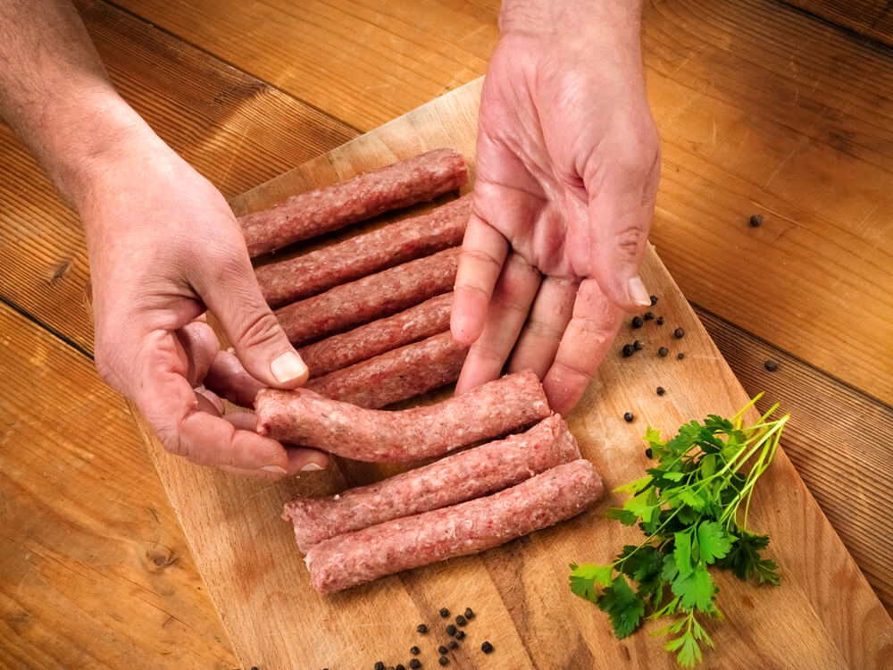 Preparation of Cevapi on a Wooden Board, Top View